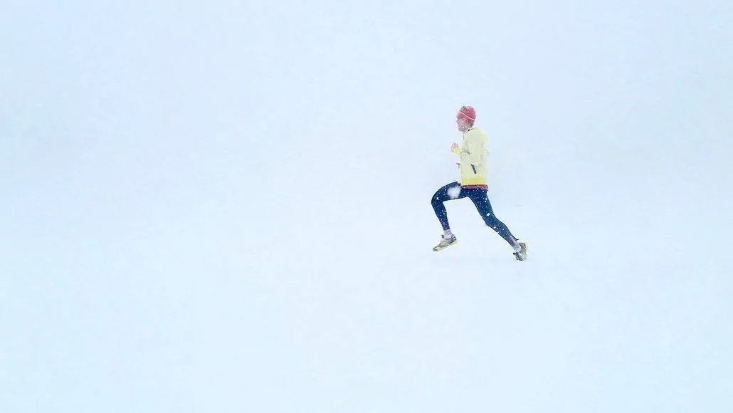 Man sprinting in the snow