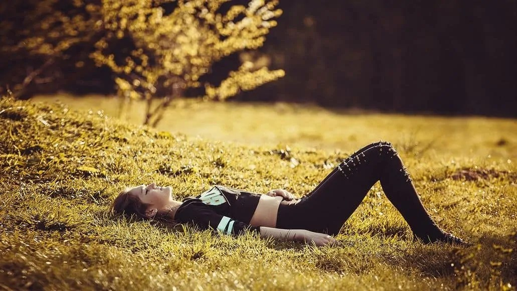 Woman sleeping stress free in grass