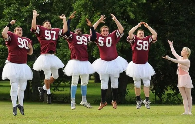 football players in ballet tutus
