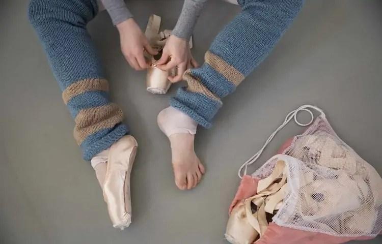 ballerina wearing leg warmers