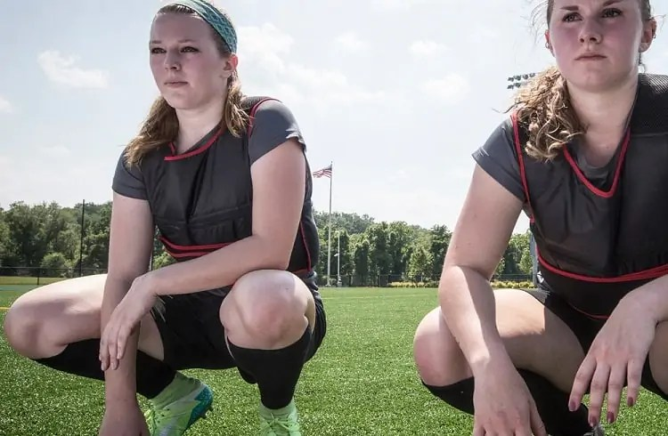 female soccer players with weighted vests