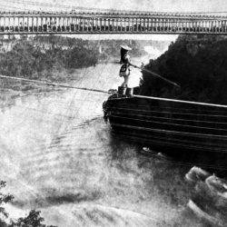 A woman crosses on a tightrope, illustrating the problem of uncertain work