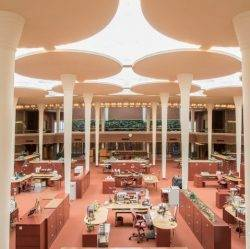The Johnson Wax building designed by Frank Lloyd Wright was an early example of open plan office design