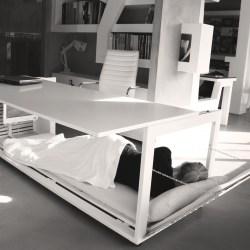sleeping under a convertible desk
