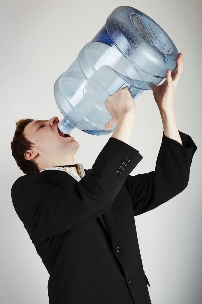 bigstock-Man-With-Huge-Water-Bottle-1999993-1000x1505