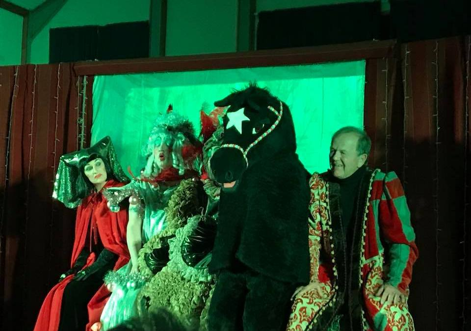 Pantomime horse on stage with actors