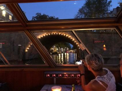 Tourist taking photos of the 15 Bridges view