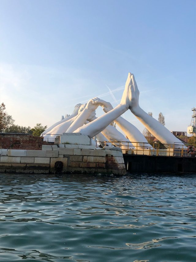 Best Things to Do in Venice: a Biennale sculpture at the Arsenale, as seen from the lagoon.