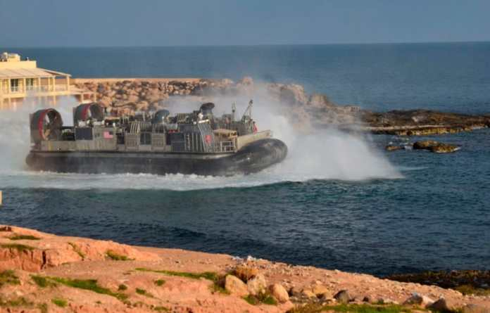 U.S. amphibious hovercraft departs with evacuees from Janzur, west of Tripoli, Libya