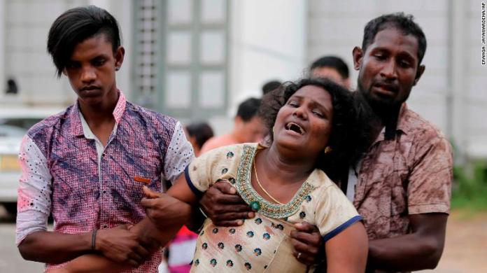 More than hundred were killed and hundreds more hospitalized with injuries from eight blasts that rocked churches and hotels in and just outside of Sri Lanka's capital on Easter Sunday, officials said, the worst violence to hit the South Asian country since its civil war ended a decade ago.