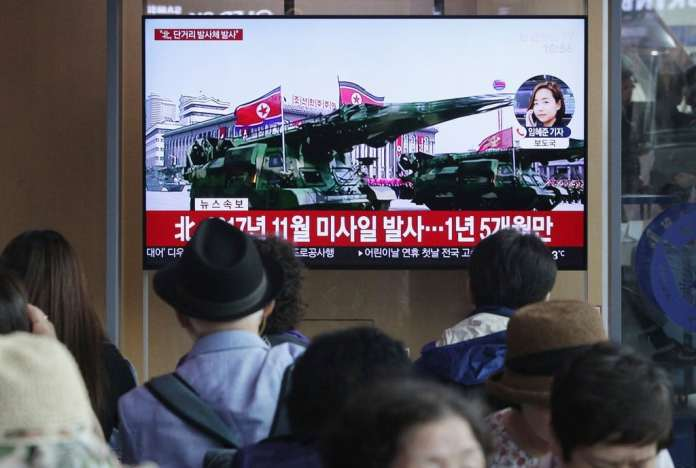 A TV broadcast in Seoul, South Korea, showing file footage of North Korea's missiles on Saturday. North Korea fired several unidentified short-range projectiles off its eastern coast.
