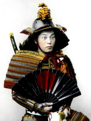 Japan warrior in full armor. Samurai with sword, helmet and fan