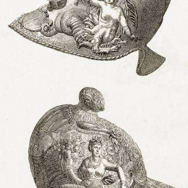 Warrior Helm. Renaissance Helmet from crafted iron. Museum of Artillery, Paris. Italian workmanship. Chiemerical ornaments
