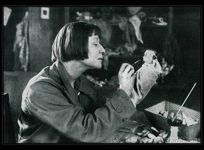 Lotte Pritzel at work in her studio. Art doll Artist. Art Deco costume dolls.
