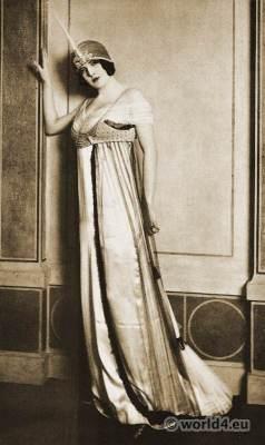 Paul Poiret - Paris 1912. Evening dress in white satin. Art-nouveau fashion. Vintage Haute couture costume.