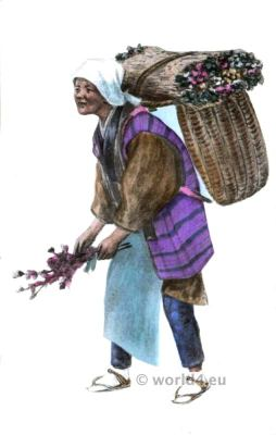 Flower seller. Traditional Japan costume. Native Japanese female.