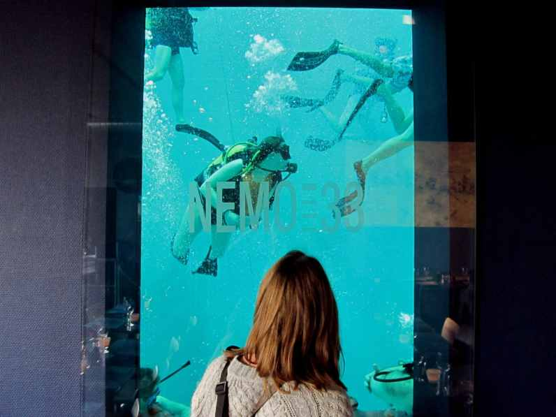 nemo 33 looking at divers