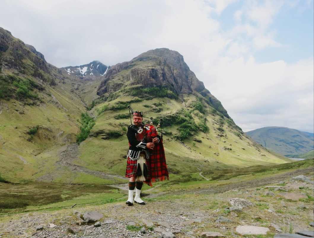 Bagpiper Glencoe Highlands Scotland