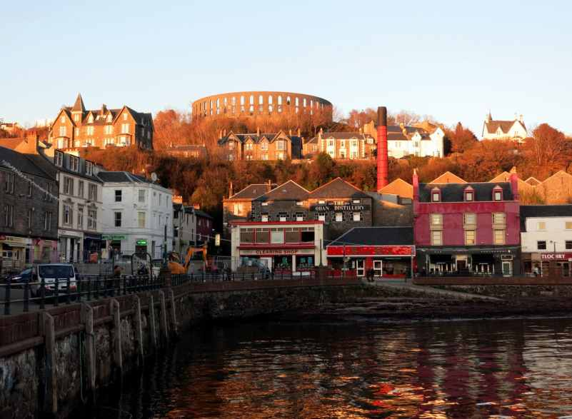 Oban harbour distillery McCaig's Tower Scotland sunset