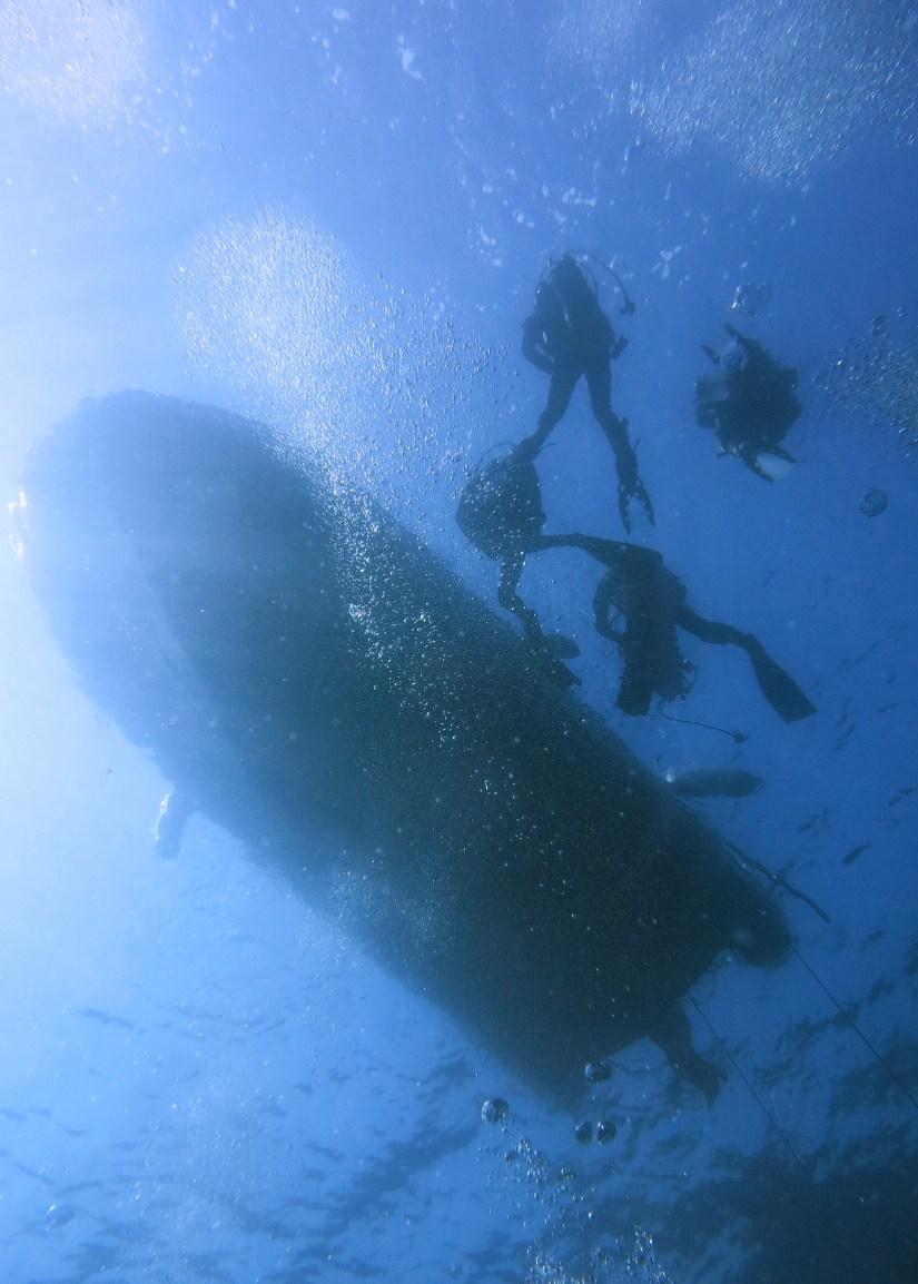 below the boat scuba divers Marseille