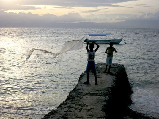 Kids playing with a kite Panagsama beach Moalboal Cebu Philippines