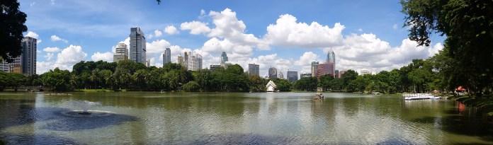 Bangkok skyline from inside Lumphini Park. A beautiful oasis in the city.