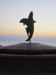 The Malecon has many sculptures, some made of bronze and some made of sand.