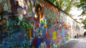 The graffitti on the Lennon Wall symbolizes peace and unity.