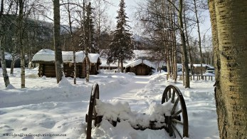 Log cabins, pine trees and snow. All very rustic.