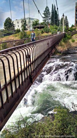The Spokane River runs rapidly beneath this bridge.