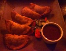 Crab and bacon wontons with wasabi guava dip from Keoki's Paradise in Koloa.