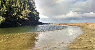 Where Lumaha'i River meets the Pacific Ocean.