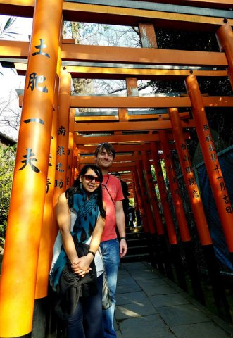 The author and boyfriend stand in front of a set of vermilion torii gates.