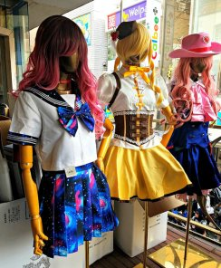Check out some Lolita outfits at shops along this road.