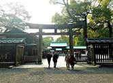 A torii gate leading into Meiji Shrine.