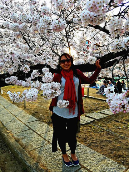 Backlit by the setting sun, surrounded by cherry blossoms...