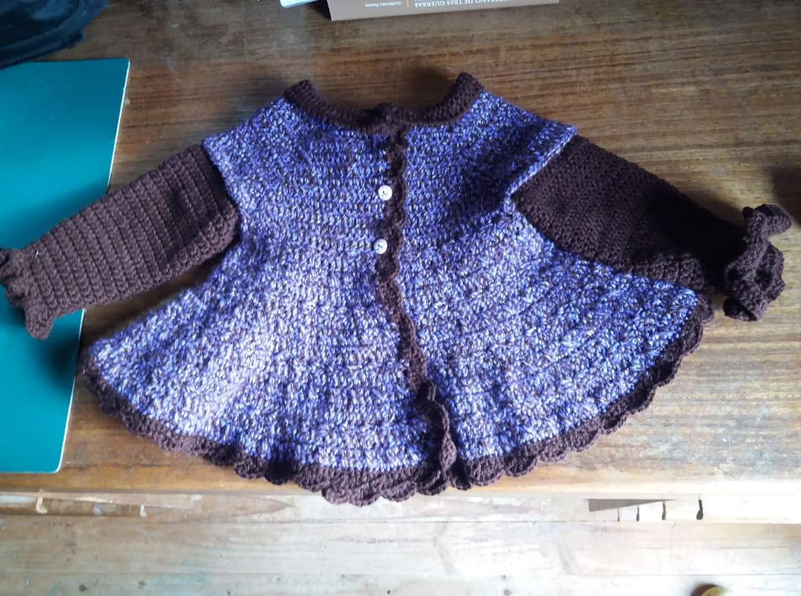 Sweater with a swing