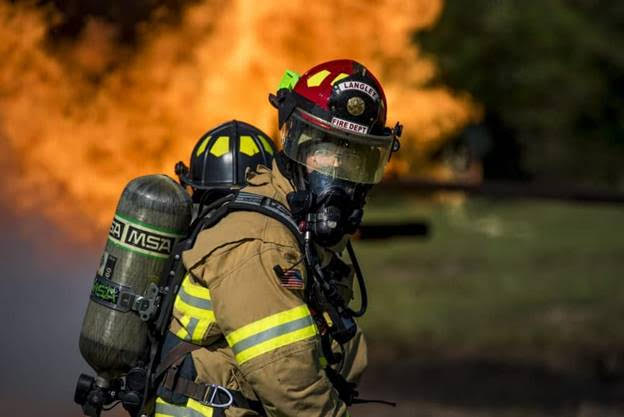 U.S. Air Force fire fighter during a training drill at Joint Base Langley-Eustis, Virginia, on Sept. 19, 2018. - U.S. Air Force photo by Staff Sgt. Areca T. Bell)