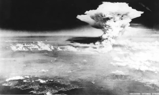 Mushroom cloud of unspeakable destruction rises over Hiroshima following the first wartime dropping of an atomic bomb on August 6, 1945