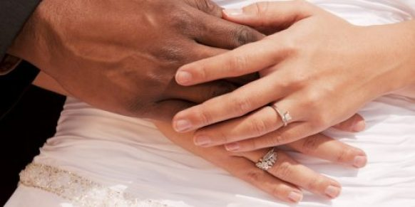 Multi Ethnic Bride and Groom Holding Hands