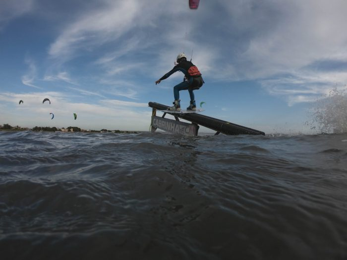 kiteboarder riding a slider in Sicily flatwater Italy features world class kiteboard academy