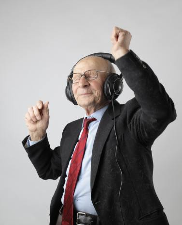 old man wearing headphones