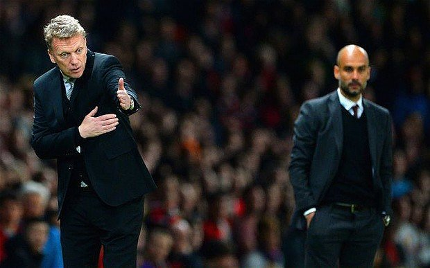 Moyes Orchestrates Tactics As Guardiola Looks On (Credit: Getty Images)