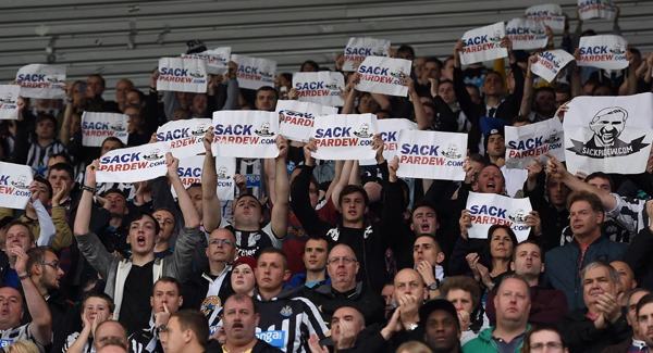 Angry Newcastle fans displaying banners in protest to sack Pardew.