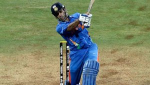 Dhoni captain of India hits the winning runs watched by Kumar Sangakkara captain of Sri Lanka to secure victory during the 2011 ICC World Cup