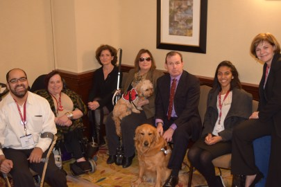Six people with varied disabilities and two service dogs