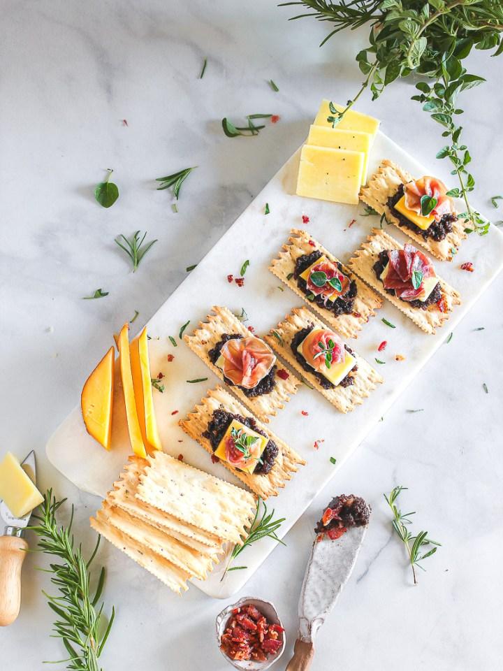 a platter of croccantini, gruyere, and prosciutto