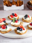 A slice of cracker crisps with mascarpone and berries
