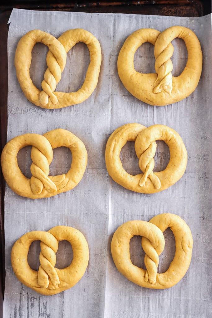 pumpkin pretzels ready to be baked