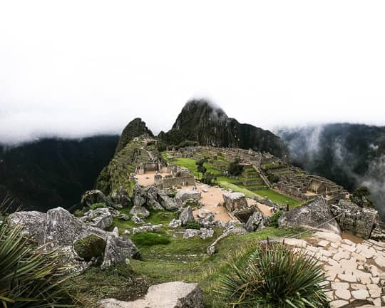 machu picchu ruins on a cloudy day